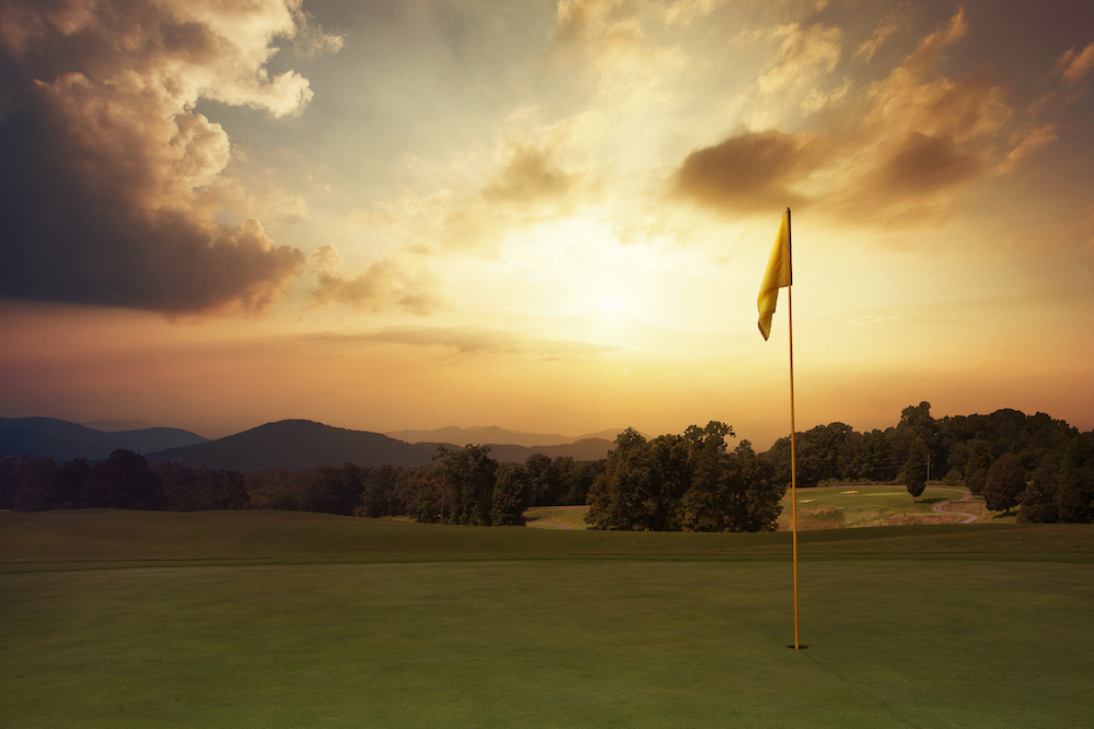 golfing in the summer in the mountains, sunset on a mountain golf course