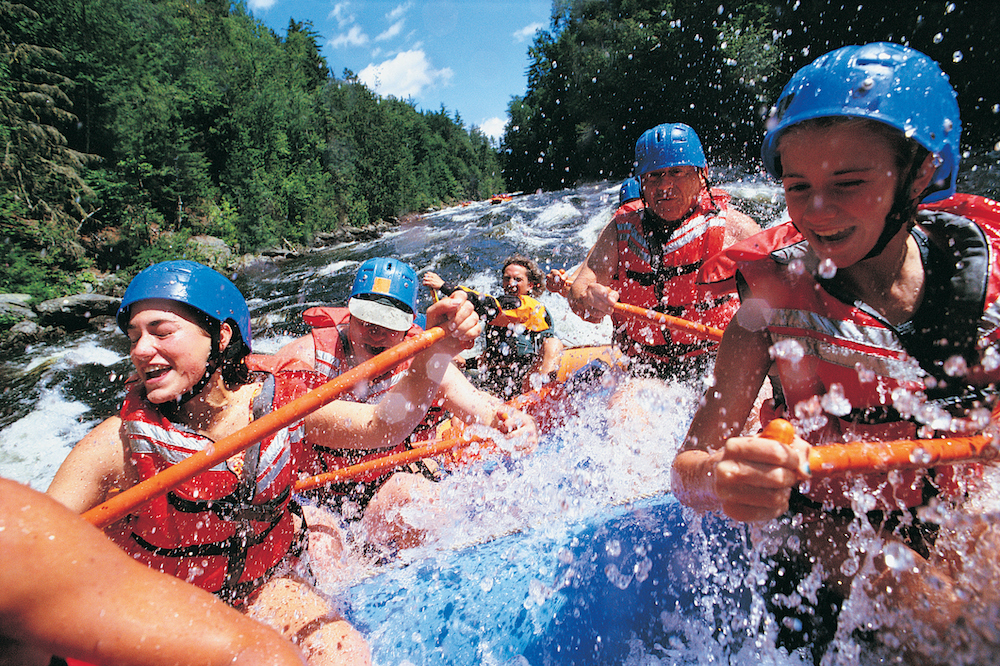 family on white water rafting trip